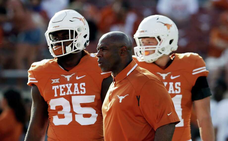 Texas head coach Charlie Strong, center, watches his players warm up, Sept. 10, 2016.Keep going for a look at the highest paid coaches in college football. Photo: Eric Gay, STF / AP
