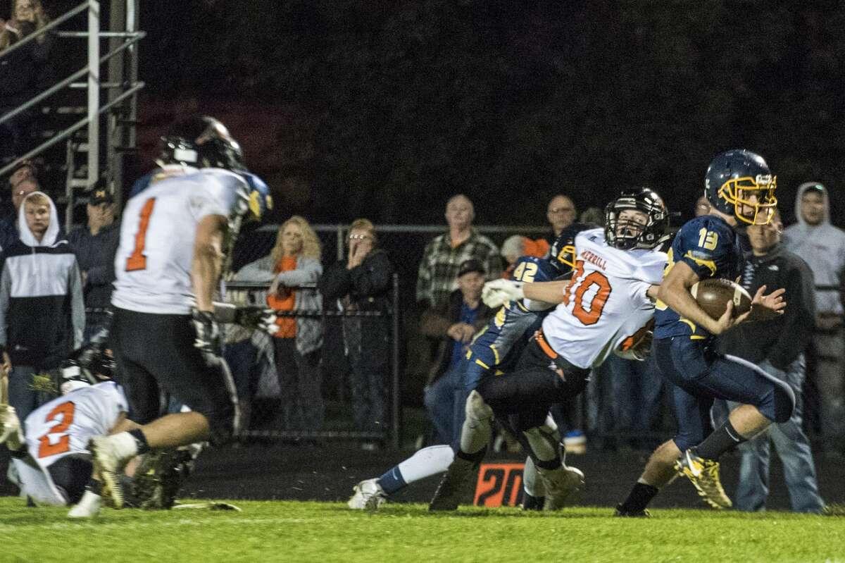 Breckenridge junior Caleb Hurt runs the ball toward the end zone as Merrill sophomore Montana Glazier tries to tackle him at Breckenridge High School on Friday.