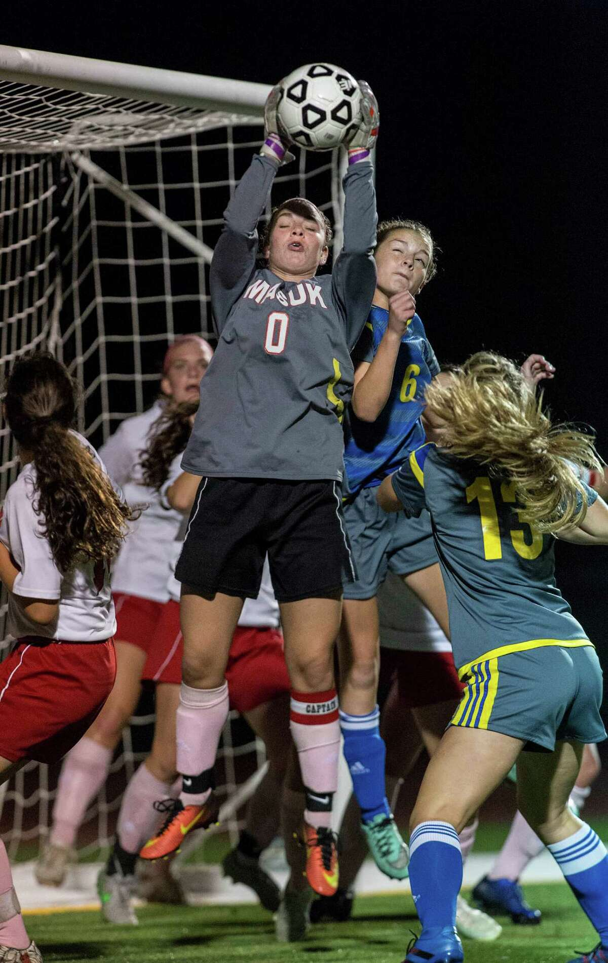 Masuk High School goalie Calli Sederquest makes a save on a corner kick during a girls soccer game against Newtown High School played at Masuk High School, Monroe, CT on Friday, October 7, 2016.