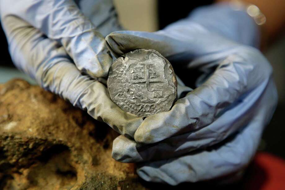 This silver coin was recovered from the wreckage of the Whydah off Cape Cod. Other finds have included fragments of rare African gold jewelry and canons. Photo: Steven Senne, STF / Copyright 2016 The Associated Press. All rights reserved.