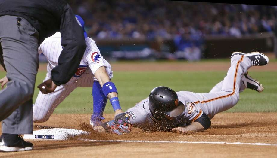 San Francisco Giants' Conor Gillaspie is picked off 1st base as Chicago Cubs' Javier Baez applies the tag in 3rd inning in Game 1 of the National League Division Series at Wrigley Field in Chicago. IL, on Friday, October 7, 2016. Photo: Scott Strazzante, The Chronicle