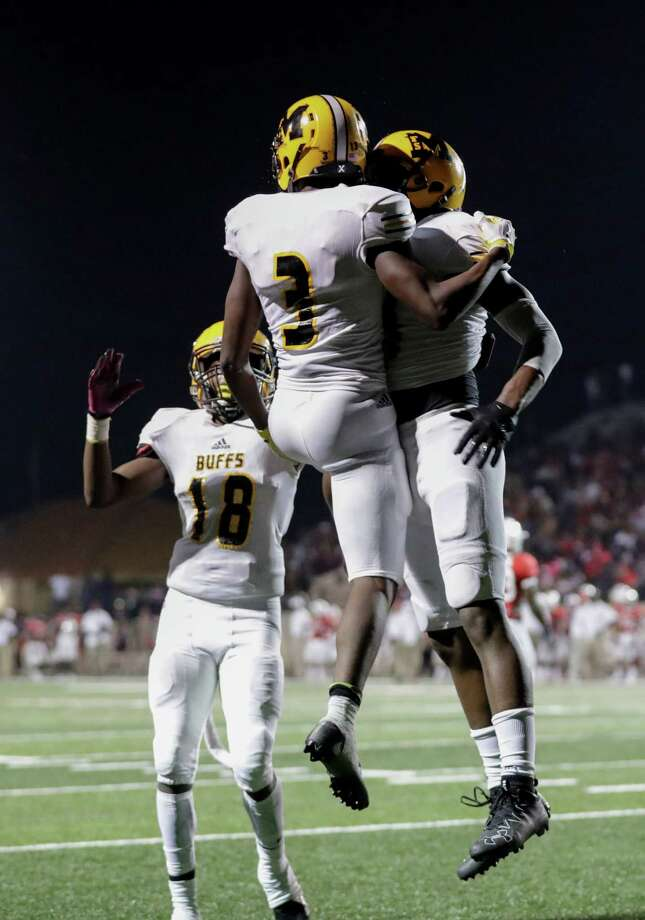 Marshall Buffalos Jabari James (18) celebrates with wide receiver Henry Thomas (3) and teammates after a touchdown during the high school football game between the Marshall Buffalos and the Manvel Mavericks at Memorial Stadium in Alvin, TX on Friday, October 7, 2016.  The Mavericks lead the Buffalos 49-6 at halftime. Photo: Tim Warner, For The Chronicle / Houston Chronicle