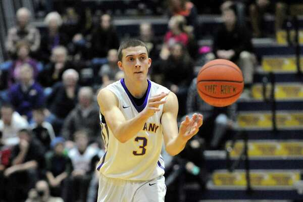 UAlbany's Joe Cremo passes the ball during their America East men's basketball opener against UMBC at the SEFCU Arena on Wednesday Jan. 6, 2016 in Albany, N.Y.  (Michael P. Farrell/Times Union)
