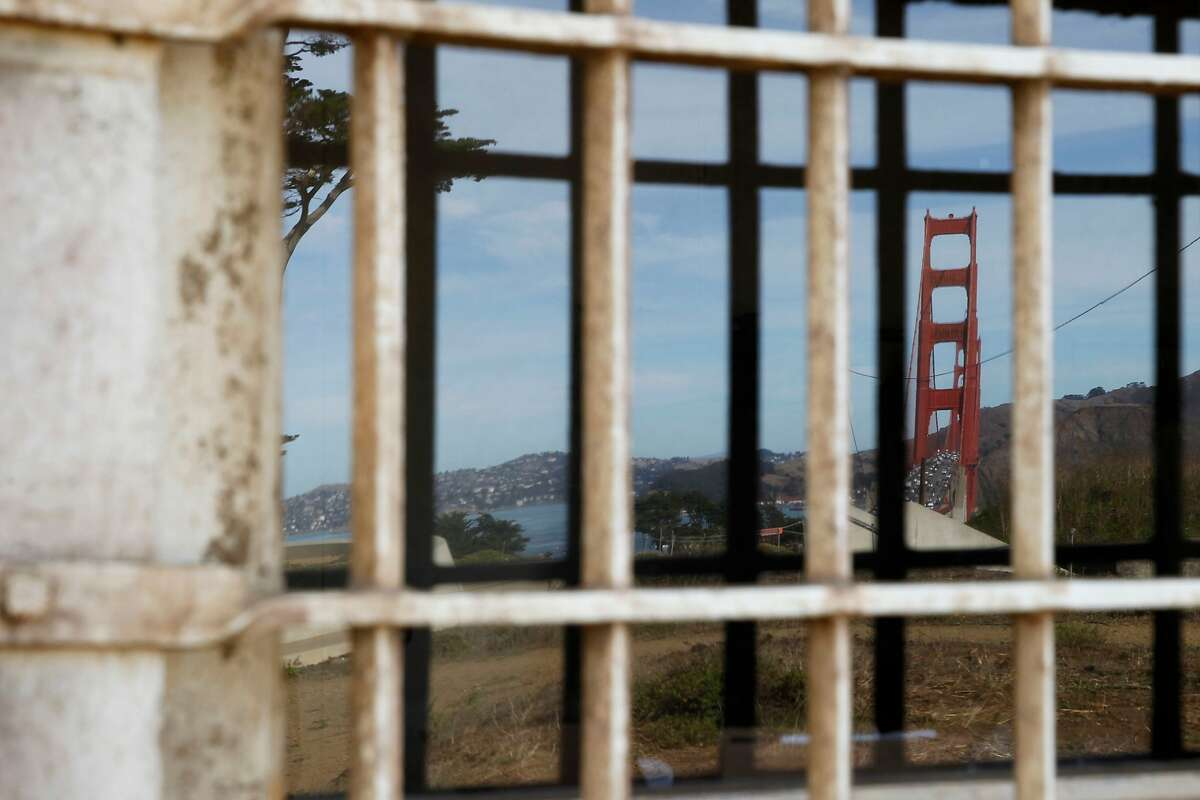 A reflection of the Golden Gate building is seen in the window of the Fort Winfield Scott at Langdon Court building in the Presidio on Friday, Oct. 7, 2016 in San Francisco, Calif.