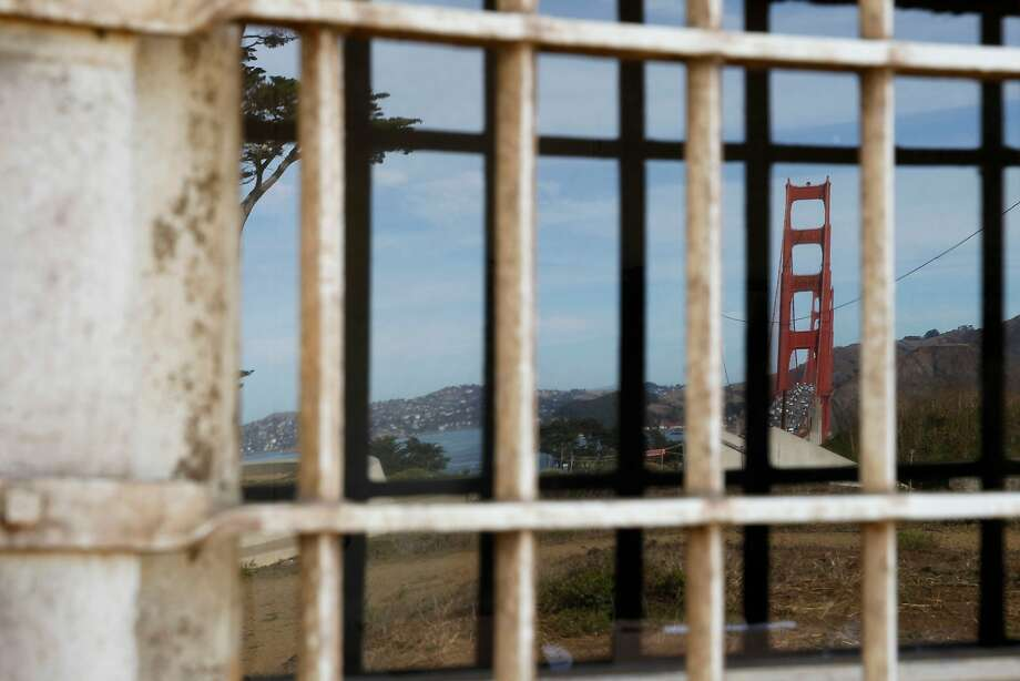 A reflection of the Golden Gate Bridge building is seen in the window of Fort Winfield Scott at Building 1648 on Langdon Court in the Presidio. Photo: Gabriella Angotti-Jones, The Chronicle