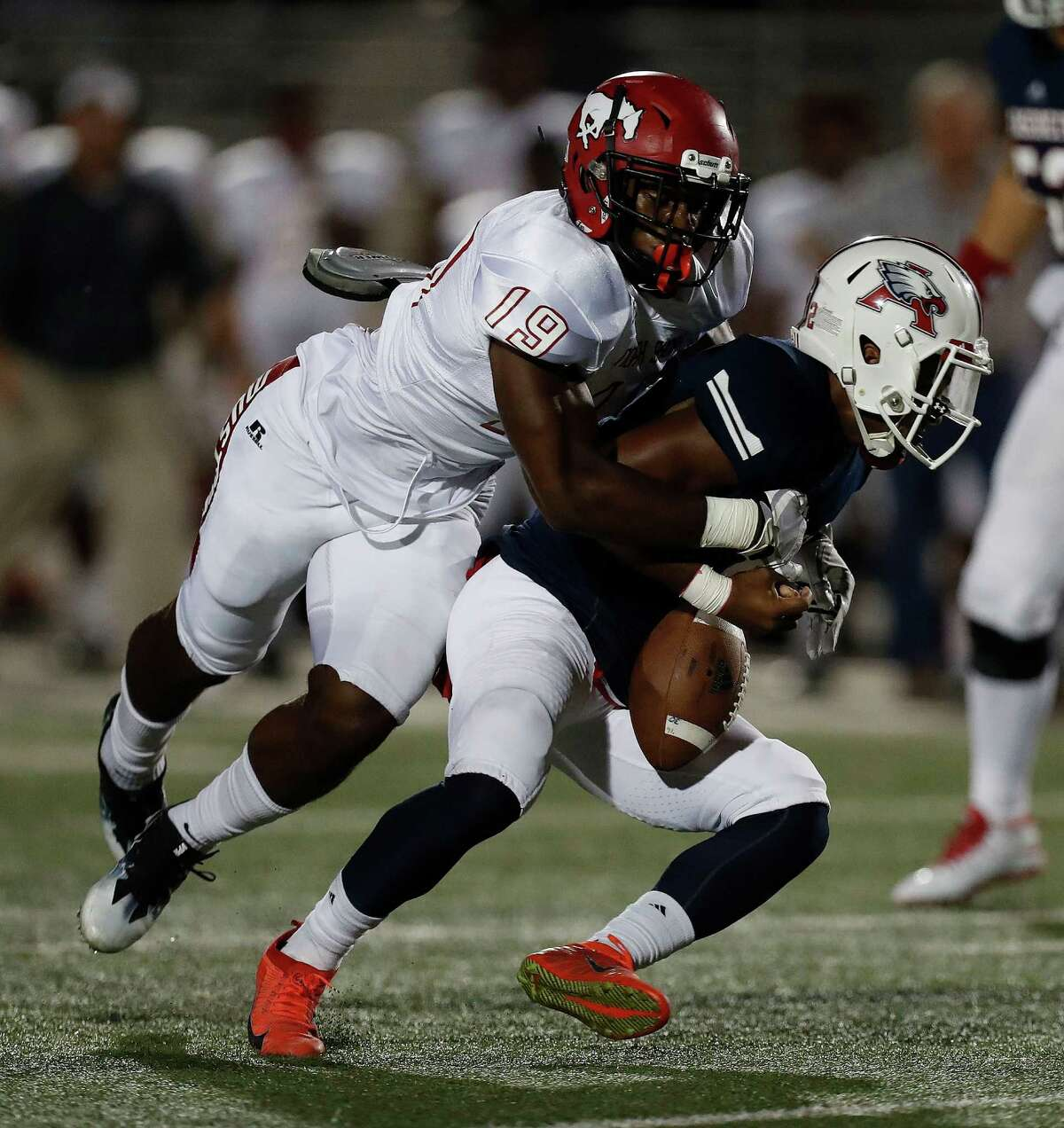 Atascocita quarterback Daveon Boyd gets sacked and has the ball stripped out of his hands by North Shore defensive end K'lavon Chaisson.
