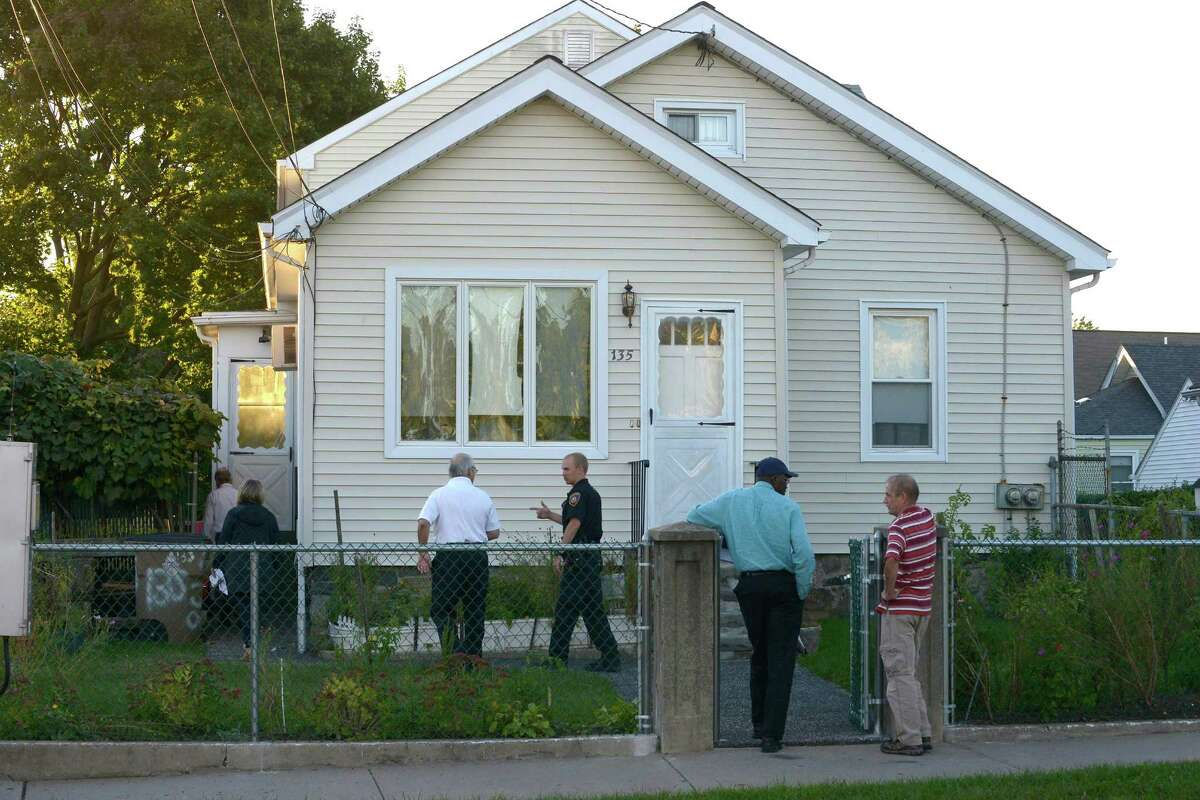 A task force from the fire marshal office, health department officials, zoning officers and a police officer conduct an unannounced safety inspection at a two family home on West Avenue in Stamford.