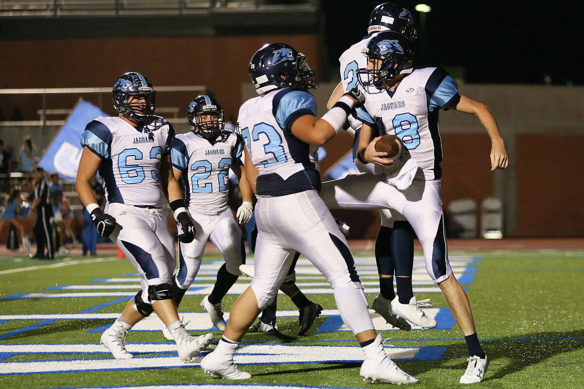 Johnson's Grant Huff (right) celebrates his 24-yard touchdown run with teammates during the first half of their District 26-6A high school football game with Churchill at Heroes Stadium on Friday, Oct. 7, 2016. MARVIN PFEIFFER/ mpfeiffer@express-news.net