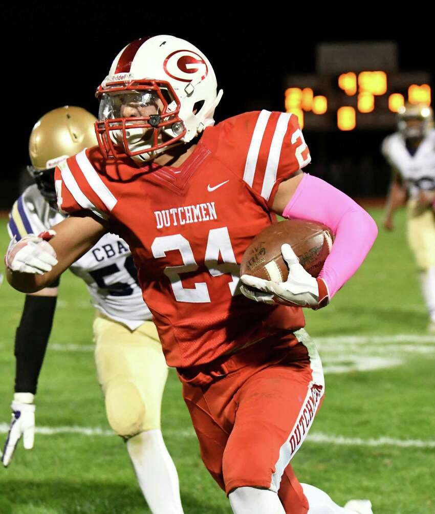 Guilderland's Joe Park, center, runs the ball for a touchdown during their football game against CBA on Friday, Oct. 7, 2016, at Guilderland High in Guilderland, N.Y. Guilderland wins 28-14. (Cindy Schultz / Times Union)