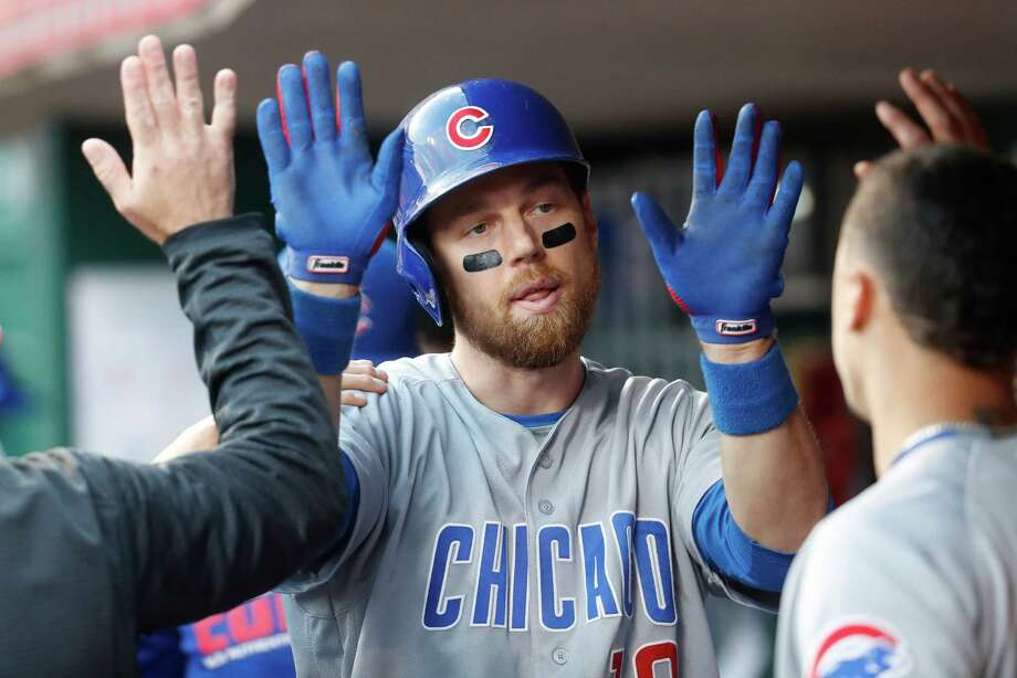 Chicago Cubs' Ben Zobrist celebrates in the dugout after hitting a solo home run off Cincinnati Reds relief pitcher Michael Lorenzen in the eighth inning of a baseball game, Saturday, Oct. 1, 2016, in Cincinnati. The Reds won 7-4. (AP Photo/John Minchillo) Photo: John Minchillo, STF / AP