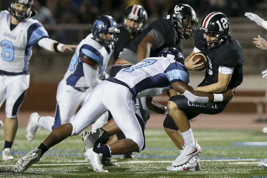 Johnson's Tanner Reed brings down Churchill quarterback Derek Perez during the second half of a District 26-6A game at Heroes Stadium on Oct. 7, 2016. Photo: Marvin Pfeiffer /San Antonio Express-News / Express-News 2016