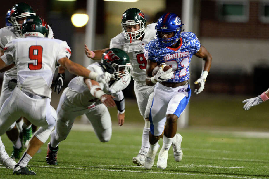 West Brook wide receiver Kandin Robertson runs by The Woodlands defenders during the first quarter at the Thomas Center on Friday evening.  Photo taken Friday 10/7/16 Ryan Pelham/The Enterprise Photo: Ryan Pelham / ©2016 The Beaumont Enterprise/Ryan Pelham