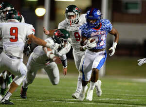 West Brook wide receiver Kandin Robertson runs by The Woodlands defenders during the first quarter at the Thomas Center on Friday evening.  Photo taken Friday 10/7/16 Ryan Pelham/The Enterprise