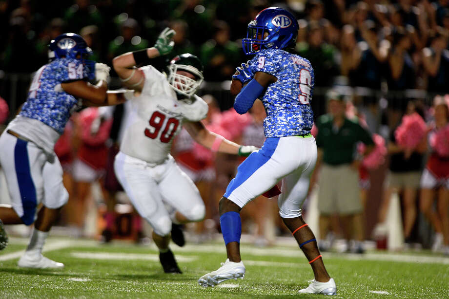 West Brook quarterback L'Ravien Elia looks to throw during the first quarter against The Woodlands at the Thomas Center on Friday evening.  Photo taken Friday 10/7/16 Ryan Pelham/The Enterprise Photo: Ryan Pelham / ©2016 The Beaumont Enterprise/Ryan Pelham