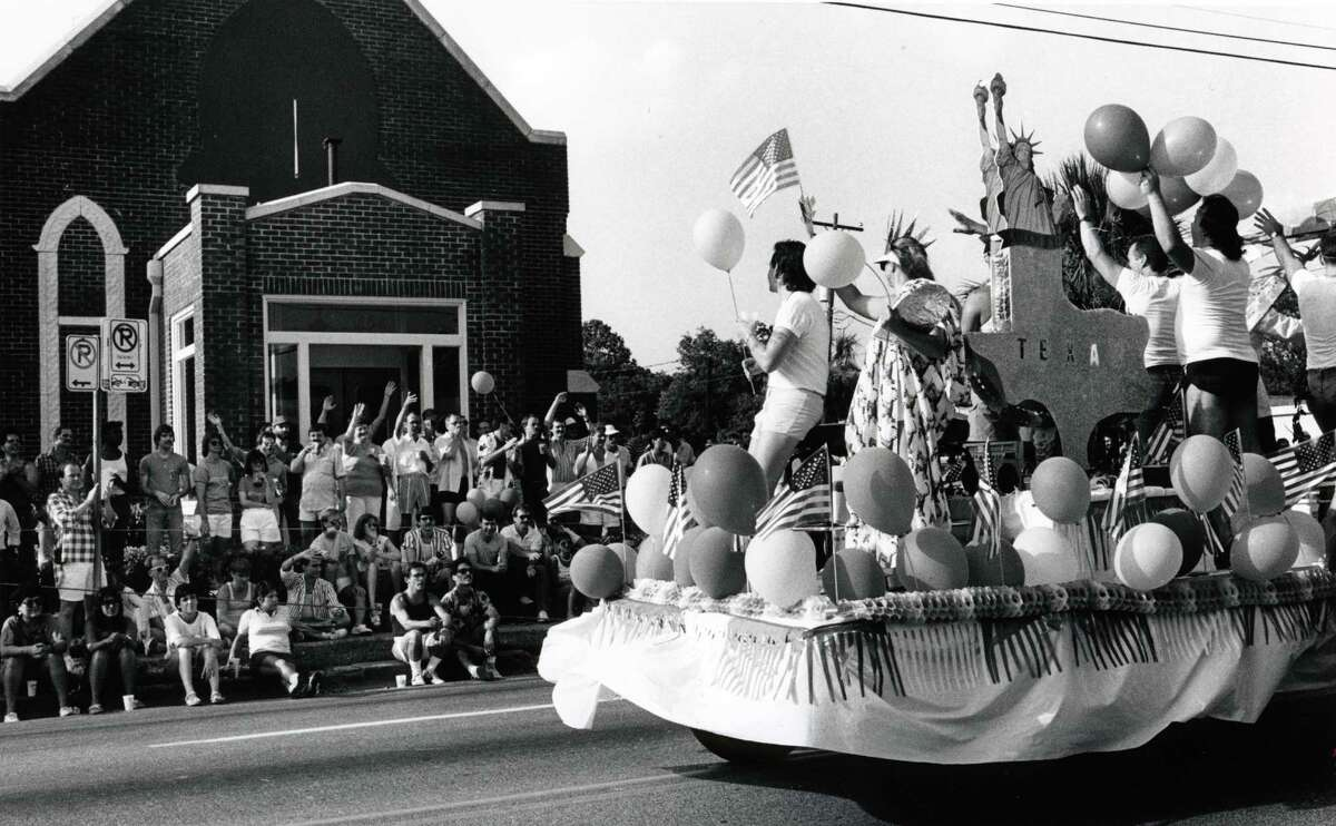 Today, Pride Houston draws thousands of people to downtown and City Hall for a huge celebration of LGBTQ (Lesbian, Gay, Bisexual, Transgender and Queer) rights.  Original caption: Spectators watch and wave as a float moves pass them on Westheimer during the eighth annual Gay Pride Parade in Houston in June 1986. There were 58 float entries for the parade.