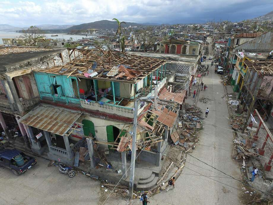 Buildings destroyed and damaged by Hurricane Matthew are seen in Jeremie, in western Haiti, on October 7, 2016. The full scale of the devastation in hurricane-hit rural Haiti became clear as the death toll surged over 400, three days after Hurricane Matthew leveled huge swaths of the country's south.  Photo: NICOLAS GARCIA, AFP/Getty Images