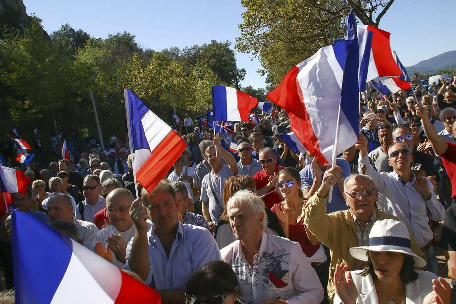 Backers of the National Front party protest the resettlement of migrants in Pierrefeu, France. Photo: Philippe Farjon, Associated Press