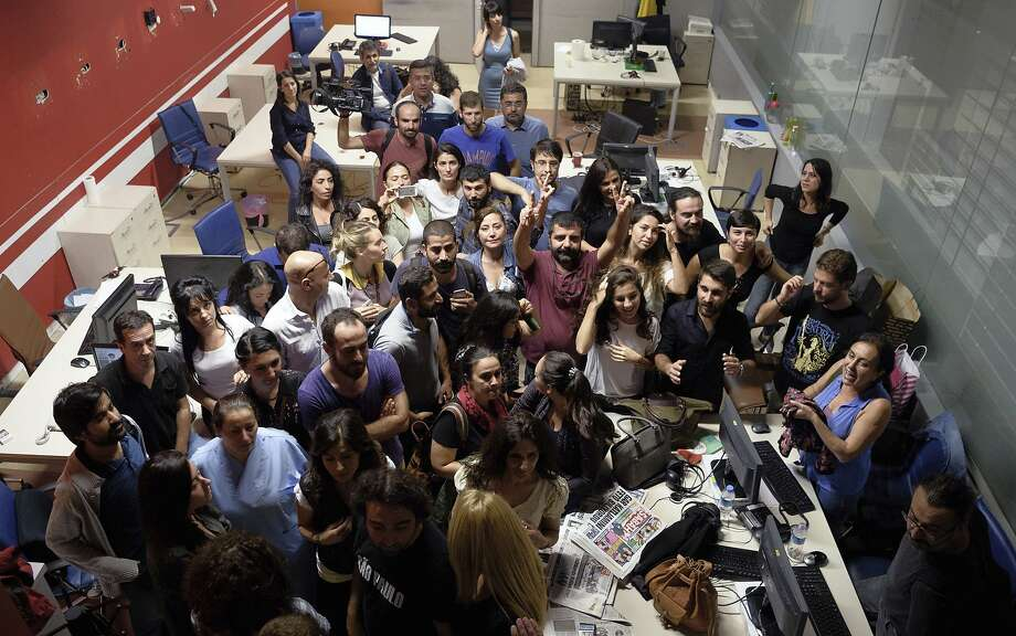 Journalists at IMC-TV gather in their Istanbul office Tuesday after police forced their station off the air during a live program. Photo: Associated Press