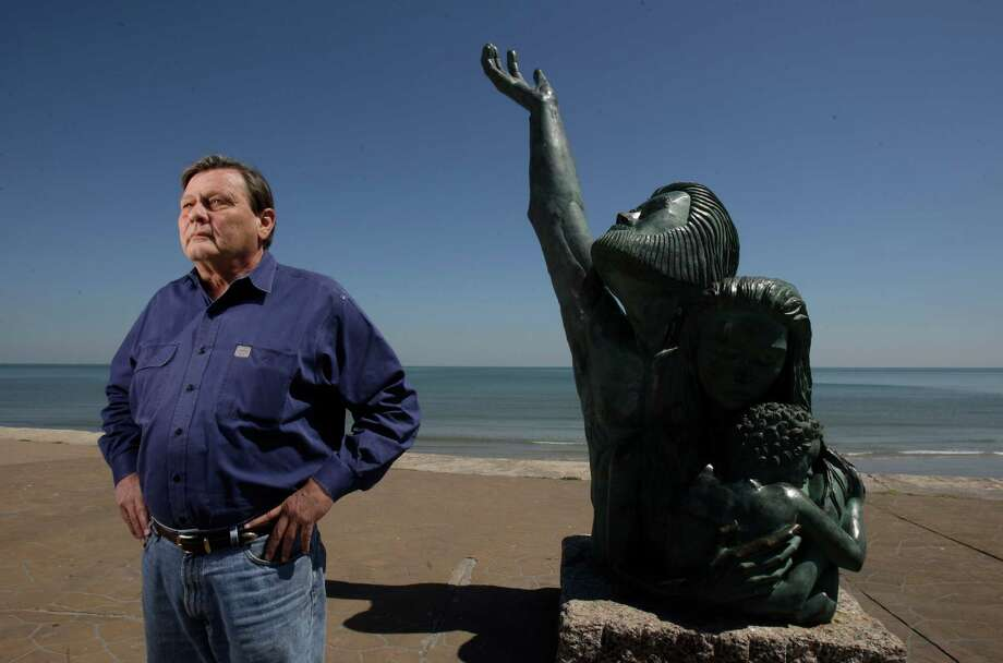 Bill Merrell,  TAMU-Galveston oceanographer, proposes to build an Ike Dike from one end of Galveston Island across Bolivar Peninsula, as seen on April 7, 2009, at the statue along the Seawall commemorates the storm that devastated the island city of Galveston in 1900. Photo: Melissa Phillip, Staff / Houston Chronicle