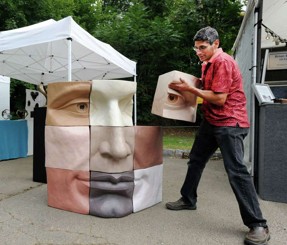 "Michael Alfano of Hopkinton, MA., displayed his sculpture puzzle (nine pieces) titled ""CUBED,"" during the  35th annual Outdoor Arts Festival at the Bruce Museum in Greenwich, Conn., Saturday, Oct. 8, 2016. Photo: Bob Luckey Jr. / Hearst Connecticut Media / Greenwich Time"