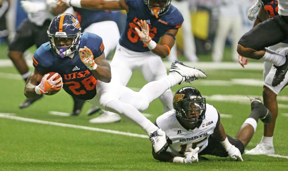 UTSA's Jalen Rodes is brought down by Southern Miss's Devonta Foster during an NCAA college football game  at the Alamodome, Saturday, Oct. 8, 2016, in San Antonio, Texas. (Ron Cortes/The San Antonio Express-News via AP) Photo: Ron Cortes, Associated Press / The San Antonio Express-News