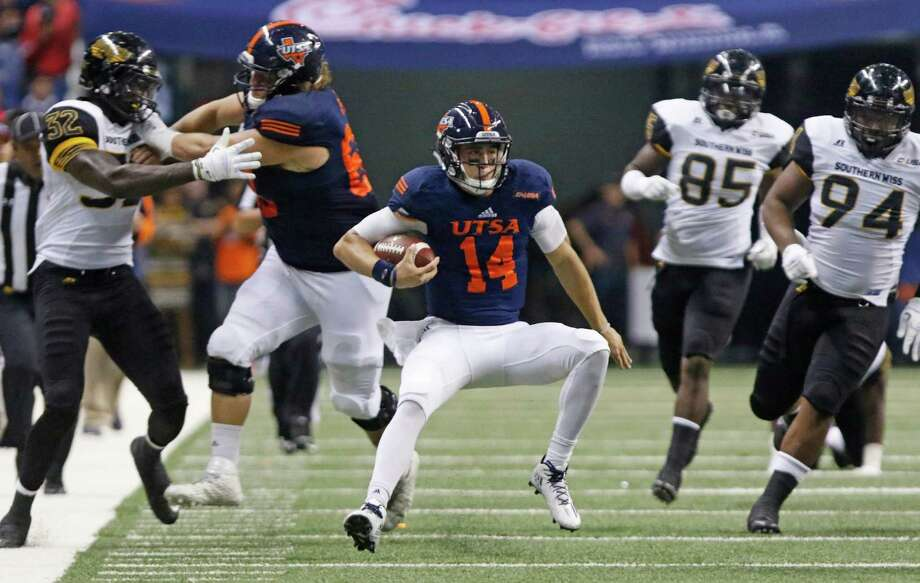UTSA quarterback Dalton Sturm runs against Southern Mississippi during an NCAA college football game against Southern Mississippi at the Alamodome, Saturday, Oct. 8, 2016, in San Antonio, Texas. (Ron Cortes/The San Antonio Express-News via AP) Photo: Ron Cortes, Associated Press / The San Antonio Express-News