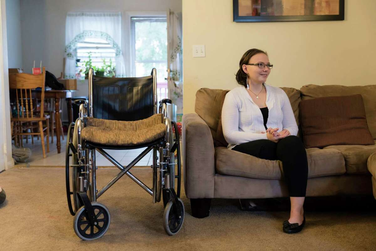 Irene Blum, 23 with her wheelchair in her home in Stamford. Blum, who survived cancer, had her leg amputated above the knee due to complications from her treatments.