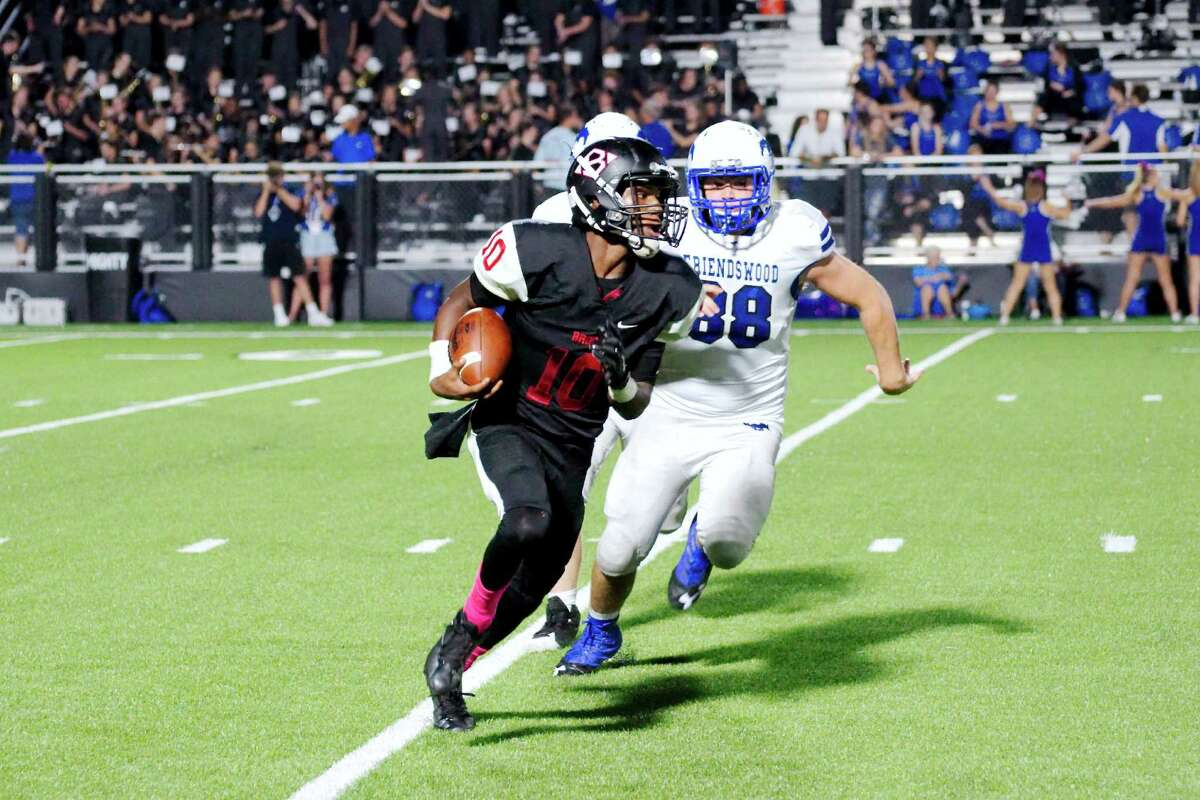 Clear Brook quarterback Mark Milton tries to elude pursuit from Friendswood during the teams' District 24-6A football game Friday night in League City.