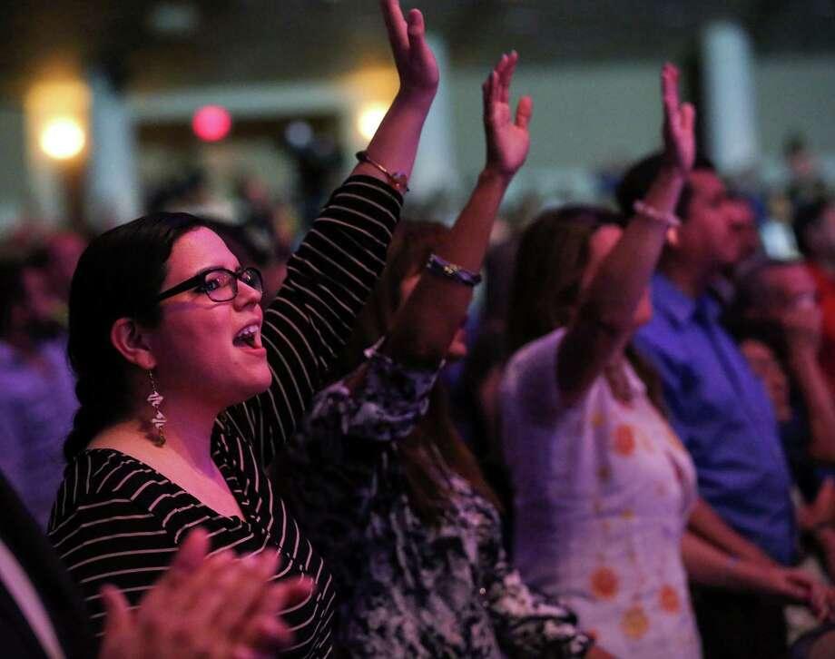 People worship during a Spanish-language service at Champion Forest Baptist Church, Sunday, Aug. 14, 2016, in Houston.  ( Jon Shapley / Houston Chronicle ) Photo: Jon Shapley, Staff / © 2015  Houston Chronicle