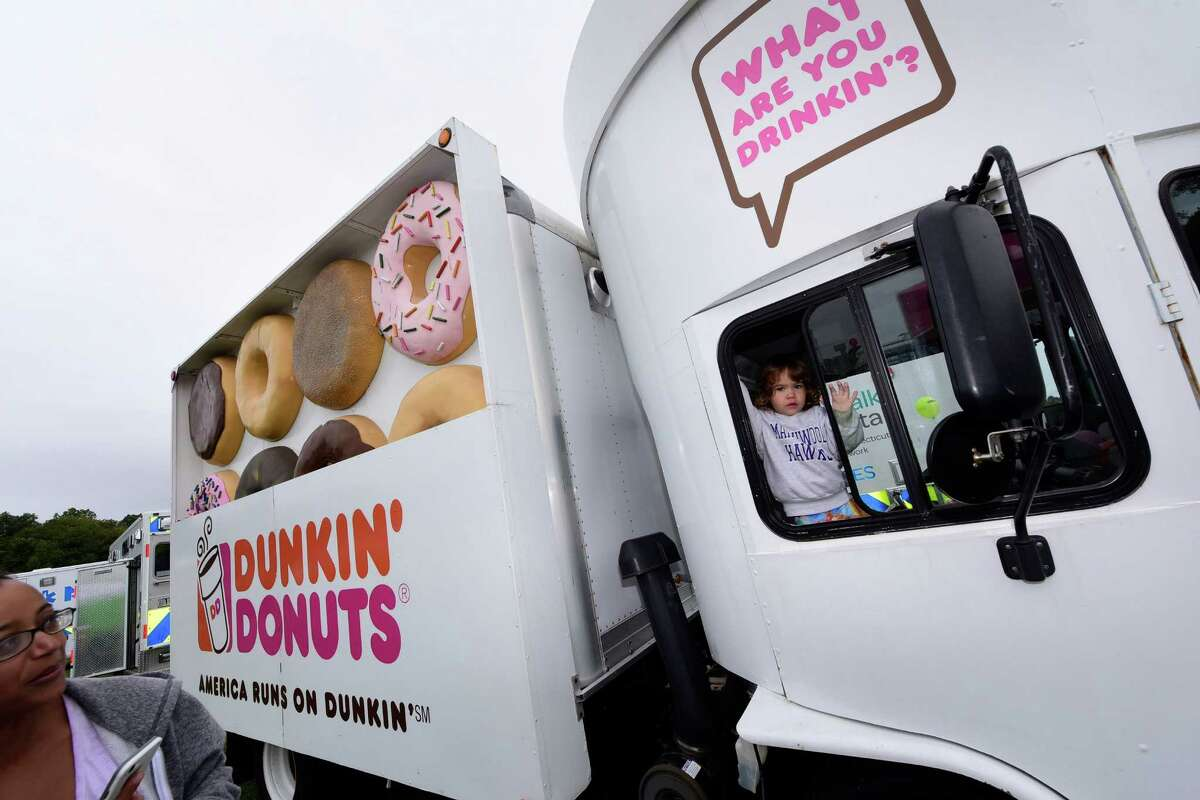 Rebecca Bryant, 3, climbs aboard the Dunkin' Donuts truck during The Human Services Council?'s 5th Annual KIDZFEST Touch-A-Truck & More Fundraiser to benefit Children?'s Connection Saturday, October 8, 2016, at Taylor Farm Park, in Norwalk, Conn. KIDZFEST offers an opportunity for families to explore construction, emergency and recreation vehicles of all sizes as well as enjoy train rides, face painting, characters meet and greet, food, and games.
