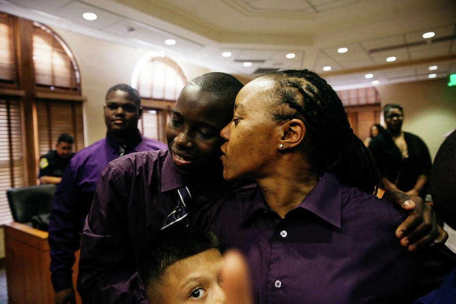 Yolanda Williams kisses her son Jayden after officially being adopted during his adoption ceremony Friday, at the Bexar County's children's court. Photo: Julysa Sosa/ For The San Antonio Express-News / Julysa Sosa/ For The San Antonio Express-News