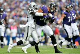 BALTIMORE, MD - OCTOBER 2:  Karl Joseph #42 of the Oakland Raiders tackles Crockett Gillmore #80 of the Baltimore Ravens in the third quarter at M&T Bank Stadium on October 2, 2016 in Baltimore, Maryland. (Photo by Larry French/Getty Images)