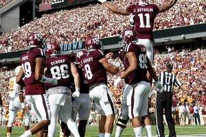 Texas A&M Aggies wide receiver Josh Reynolds (11) is lifted up by teammates after scoring a touchdown during the first quarter of a college football game at Kyle Field, Saturday, Oct. 8, 2016 in College Station.