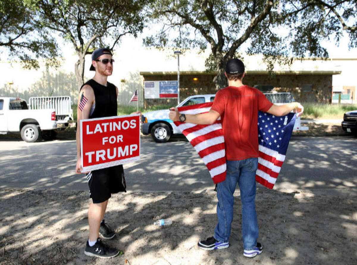 """Adam Wicks, left, and Drew Kuecholer participate a """"Latinos for Trump"""" rally on Navigation Boulevard Saturday, Oct. 8, 2016, in Houston."""