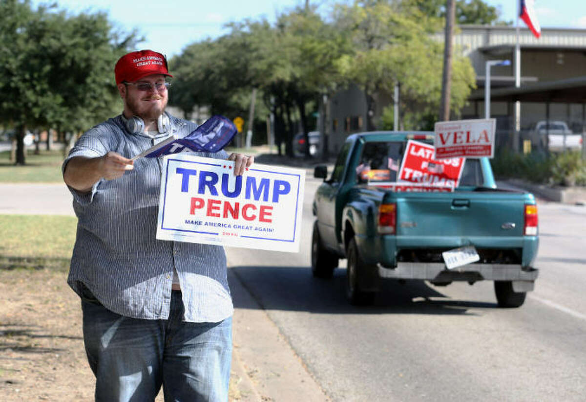 """Photos: Houston's most Republican and Democratic neighborhoods Matt Harlan greets another fellow """"Latinos for Trump"""" supporter during a rally on Oct. 8, 2016, in Houston. Keep going for a look at the reddest and bluest neighborhoods in the Bayou City."""