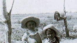 Bernardo Treviño, 6, and brother Frank, 5, pose circa 1930 near a field at a cotton farm where their parents were employed.