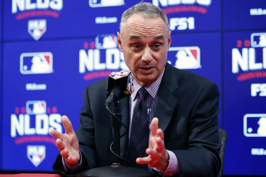 Baseball commissioner Rob Manfred speaks during the rain delay that pushed Game 2 of the NLDS to Sunday. Photo: Alex Brandon, Associated Press
