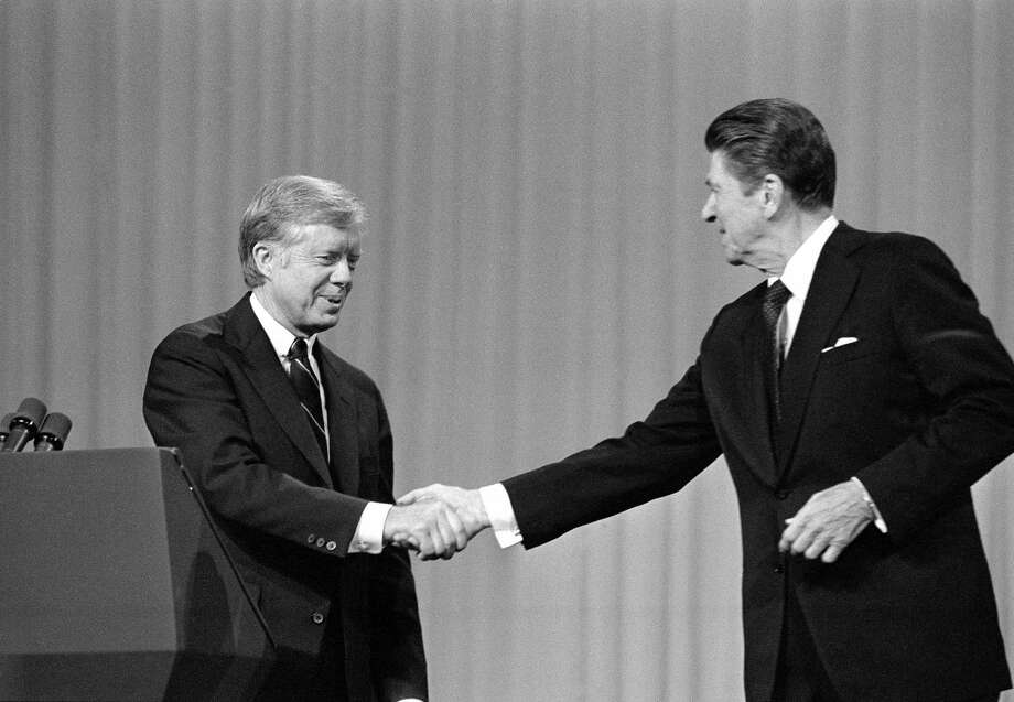 President Jimmy Carter and Republican presidential candidate Ronald Reagan were cordial to each other after their debate on Oct. 28, 1980, in Cleveland. Photo: Madeline Drexler, STF / AP1980