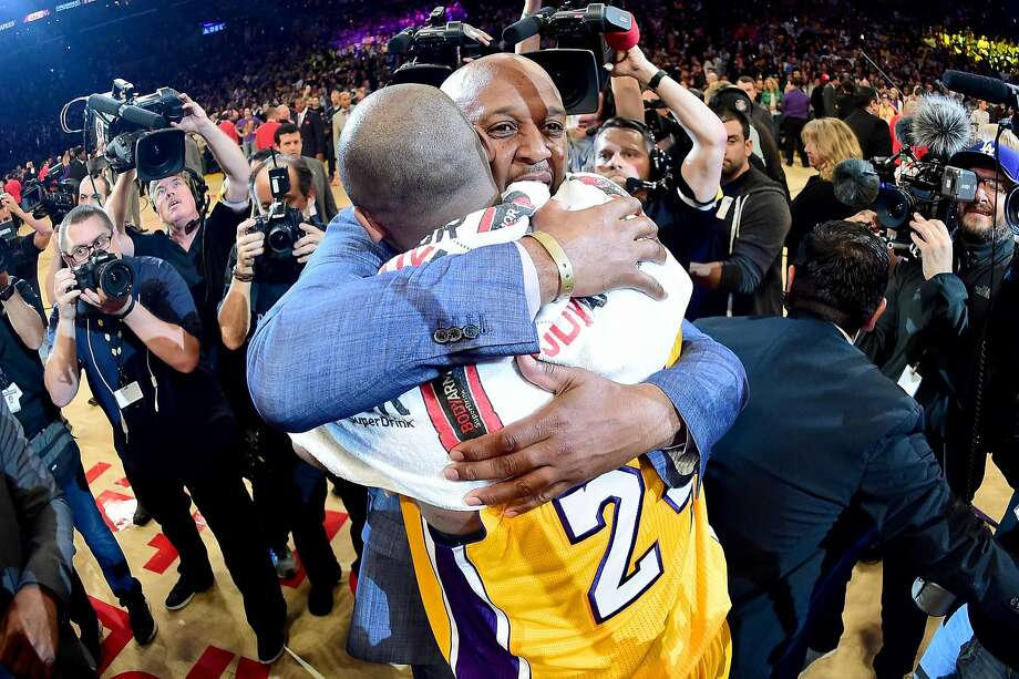 Kobe Bryant of the Lakers talks with Brian Shaw after scoring 60 points in his final NBA game at Staples Center on April 13. Shaw has returned as lead assistant to head coach Luke Walton. Photo: Harry How, Getty Images
