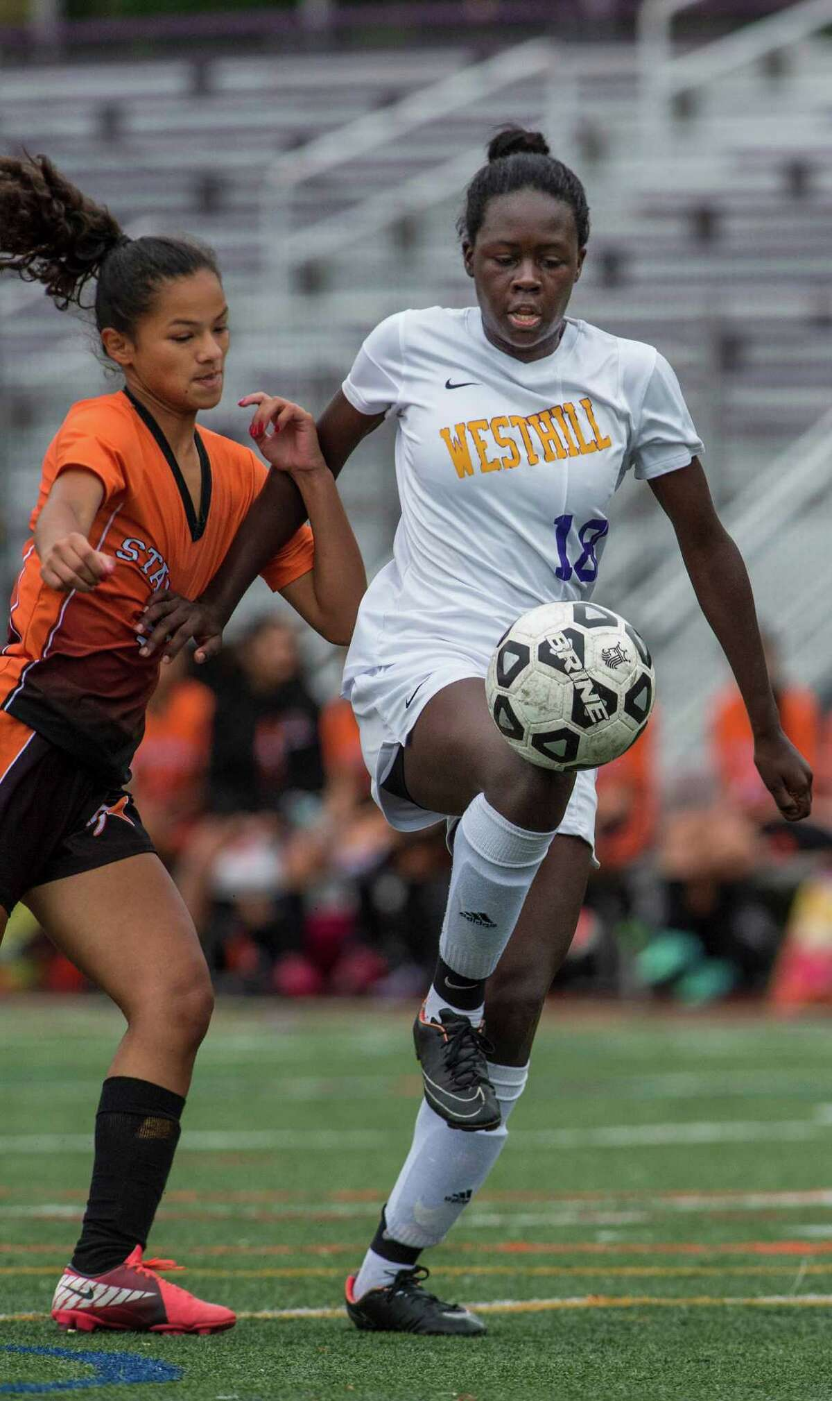 Westhill's Chelsea Domond, right, and Stamford's Estefanie Cabrera fight for the ball during a girls soccer game played at Westhill High School in Stamford on Saturday. Domond scored two goals to help Westhill capture the city championship, 3-0.