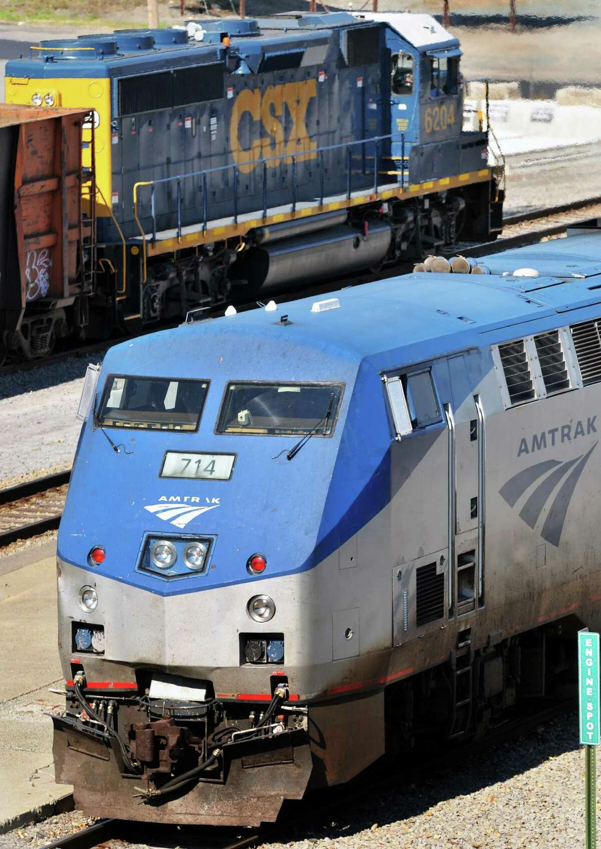 A southbound AMTRAK train and a northbound CSX freight at the Rensselaer station Tuesday afternoon October 12, 2010. (John Carl D'Annibale / Times Union)