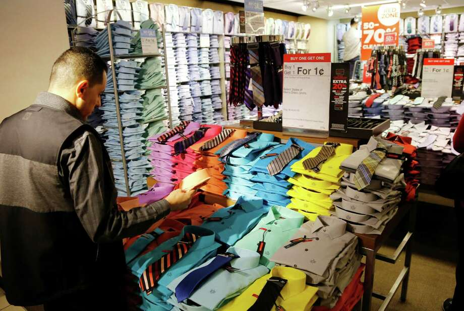 "FILE - In this Thursday, March 10, 2016, file photo, a man looks at shirts and neckties that are part of a ""Buy One Get One for a Penny"" sale at a J.C. Penney store. Consumers have a tendency to forget or neglect to take advantage of a retailer perk known as price matching, and when they do, they could be leaving money on the table. (AP Photo/Mark Lennihan, File) ORG XMIT: NYBZ404 Photo: Mark Lennihan / Copyright 2016 The Associated Press. All rights reserved. This m"