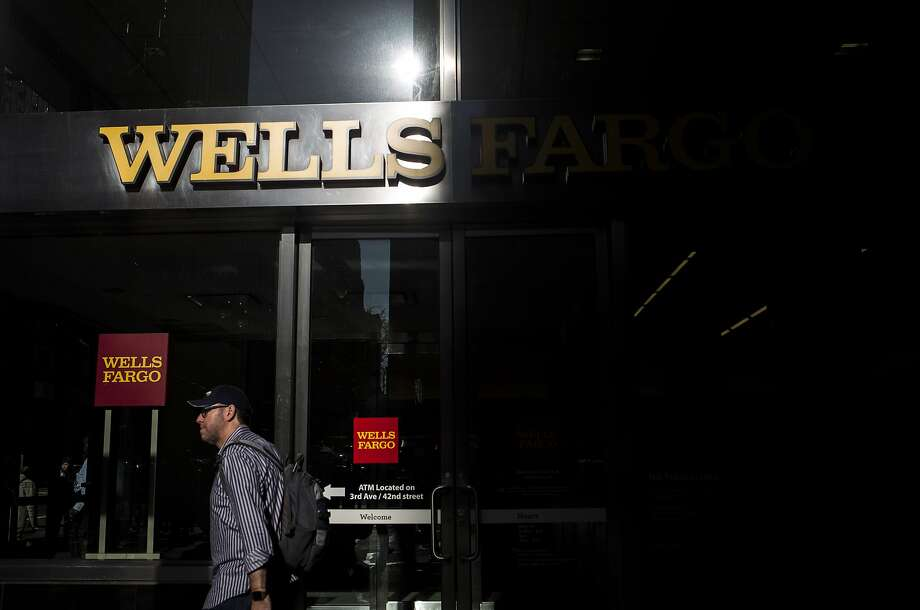 A pedestrian walks past a Wells Fargo & Co. bank branch in New York, U.S., on Thursday, Oct. 6, 2016. Wells Fargo & Co.'s senior executives should be investigated by U.S. prosecutors over the bank's unauthorized creation of customer accounts, Democrats in the U.S. Senate told Attorney General Loretta Lynch. Photographer: John Taggart/Bloomberg Photo: John Taggart, Bloomberg