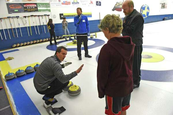 Curler Stu Howells explains proper form during the Albany Curling Club winter open house on Saturday Oct. 8, 2016 in Albany , N.Y. Held also, noon to 4 p.m. Oct. 9  (Michael P. Farrell/Times Union)