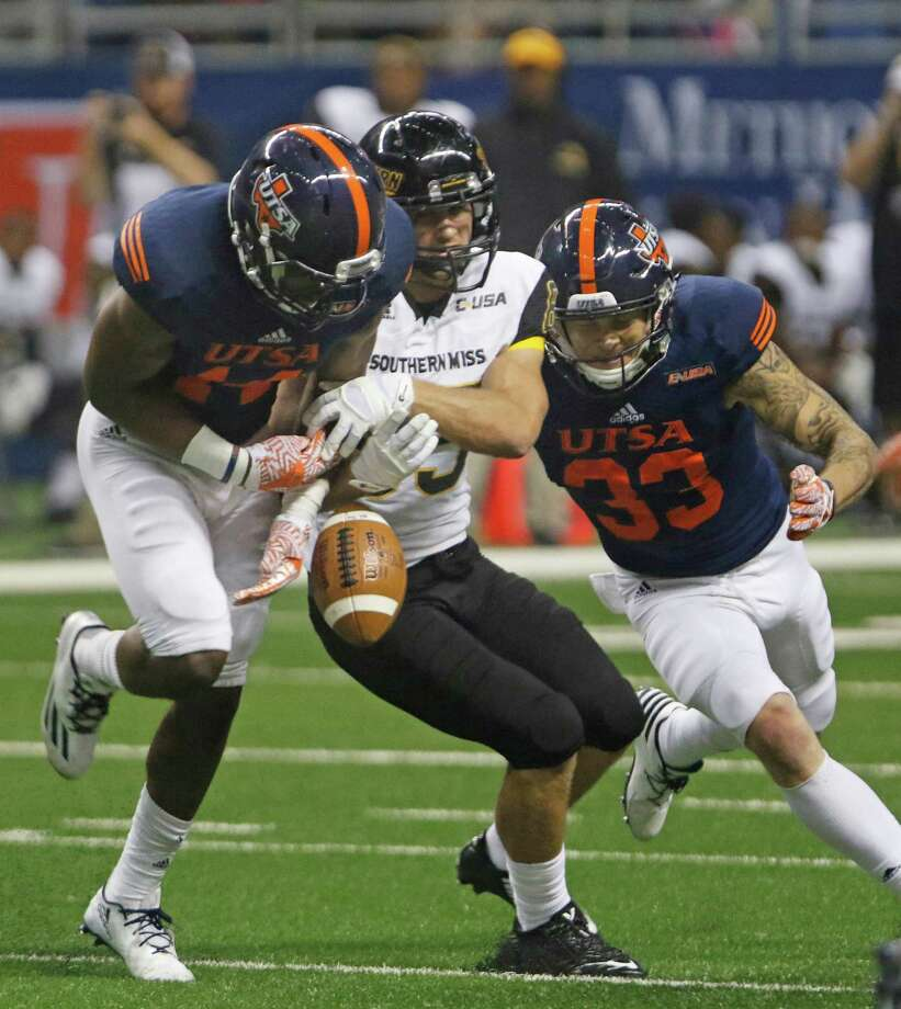 UTSA's C.J. Levine, left, and Chase Dahlqvist break up a pass intended for Southern Miss Chase Whitehead during an NCAA college football game at the Alamodome, Saturday, Oct. 8, 2016, in San Antonio, Texas. (Ron Cortes/The San Antonio Express-News via AP) Photo: Ron Cortes, Associated Press / The San Antonio Express-News