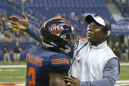 UTSA coach Frank Wilson congratulates Jarveon Williams after his TD run against Southern Miss at the Alamodome on Oct. 8, 2016.