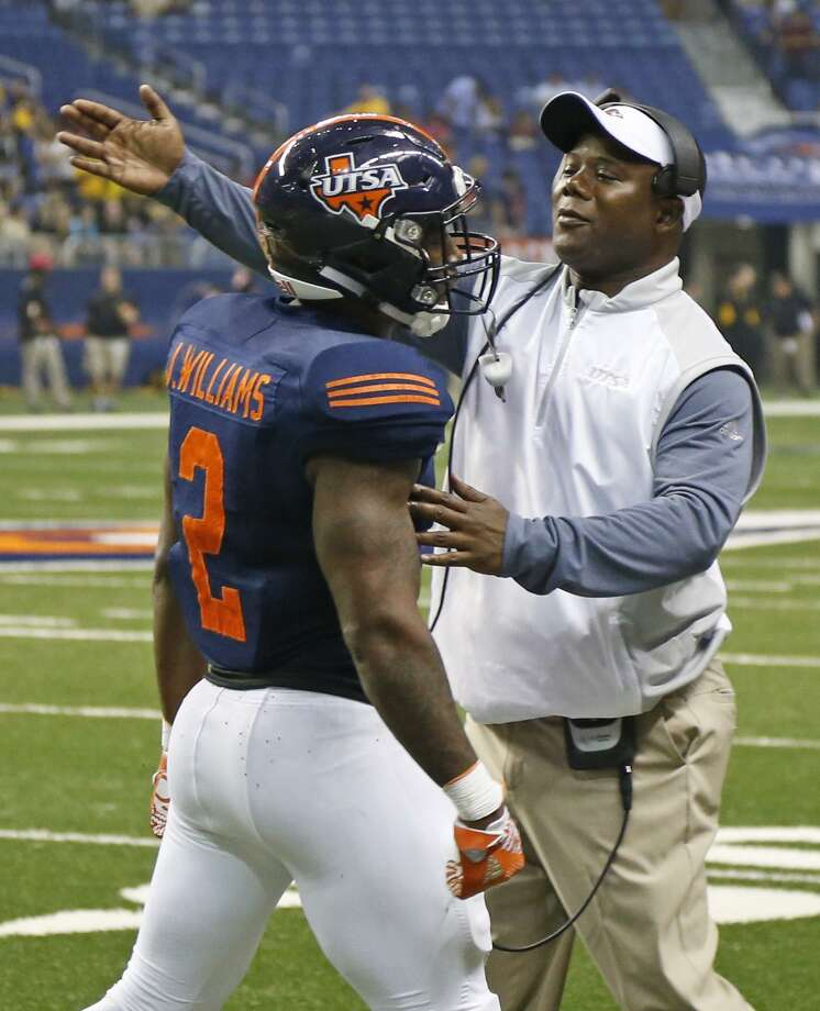 UTSA coach Frank Wilson congratulates Jarveon Williams after his TD run against Southern Miss at the Alamodome on Oct. 8, 2016. Photo: Ron Cortes /For The Express-News