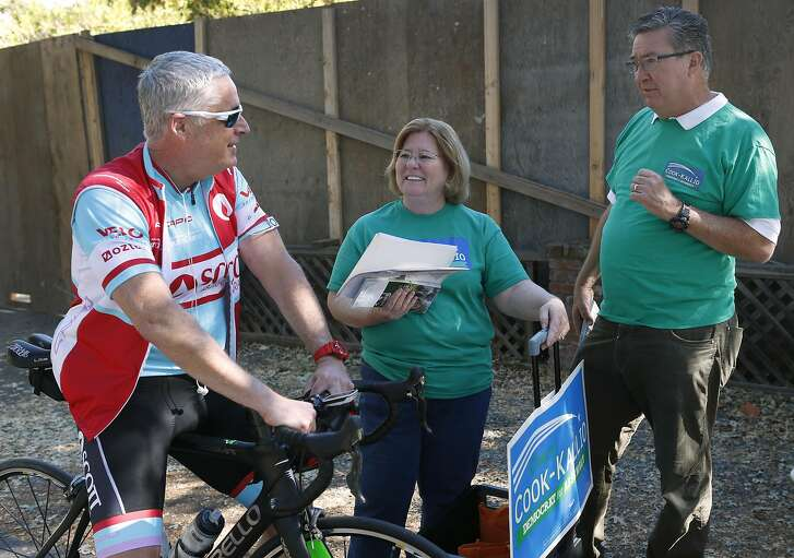 Cheryl Cook-Kallio, the Democratic candidate in the race for the State Assembly District 11 seat, meets with bicyclist Chris Lehman as she campaigns with support from Assemblyman Ken Cooley (right) from the 8th District, in Walnut Creek, Calif. on Saturday, Oct. 8, 2016.