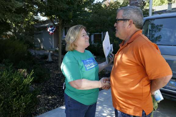 Cheryl Cook-Kallio, the Democratic candidate in the race for the State Assembly District 11 seat, meets with homeowner Art Jacobsen while campaigning in Walnut Creek, Calif. on Saturday, Oct. 8, 2016.