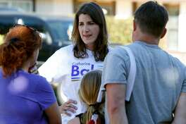 Republican Assemblywoman Catharine Baker meets Tina and Steven Wagner while canvassing for re-election to her District 16 seat in Pleasanton, Calif. on Saturday, Oct. 8, 2016.